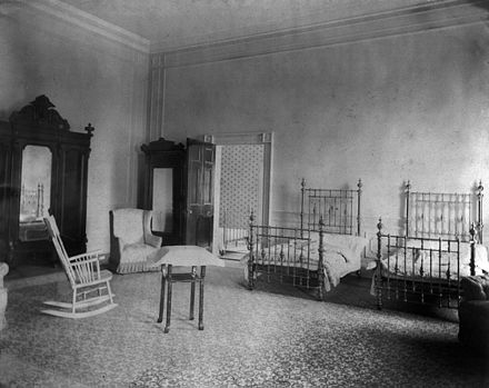 Bedroom of First Daughter Alice Roosevelt at the White House circa 1902. This room was an unnamed bedroom suite from the time of its completion in 1809 until 1860, when it was named the Prince of Wales Room. It was renamed the Lincoln Bedroom in 1929, a name it retained until the bedroom suite was removed in 1961 and the space transformed into the Family Kitchen and the President's Dining Room. Alice Roosevelt bedroom.jpg