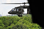 An Army UH-60 Black Hawk helicopter hovers above the ground during rescue hoist training near the Chesapeake and Delaware Canal in New Castle County, Del., Aug. 4, 2013 130804-Z-DL064-102.jpg