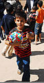 An Iraqi boy carries a soccer ball he received from Iraqi leaders during a humanitarian assistance mission at the business center in the Anbar province of Iraq Aug. 29, 2010 100829-A-CE832-002.jpg