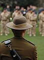 An officer from 246 Gurkha Squadron looks on as soldiers receive their Afghanistan medals. MOD 45147832.jpg