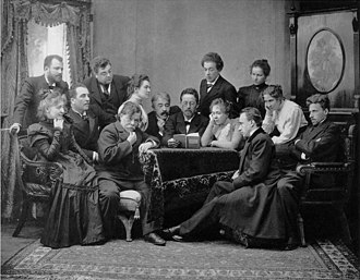 The Seagull - Chekhov reads The Seagull with the Moscow Art Theatre company. Chekhov reads (centre), on Chekhov's right, Konstantin Stanislavski is seated, and next to him, Olga Knipper. Stanislavski's wife, Maria Liliana, is seated to Chekhov's left. On the far right side of the photograph, Vsevolod Meyerhold is seated. Vladimir Nemirovich-Danchenko stands in the far left side of the photograph.