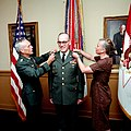 Army CHIEF of STAFF General John A. Wickham Jr. and Mrs. Ann Odom each pin a third star on the shoulders of Lieutenant General William E. Odom during his promotion ceremony at the Pentagon.jpg