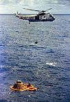 Astronaut Stuart A. Roosa, command module pilot, is hoisted inside a Billy Pugh net to a U.S. Navy helicopter.jpg