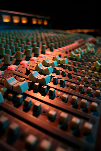 Fade (audio engineering) - Audio mixer faders in a London pub.