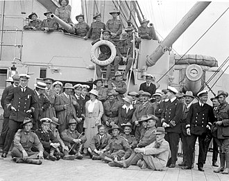 King Edward VII-class battleship - Australian soldiers touring HMS Commonwealth in 1919; note the 6-inch gun now in an open pivot mount on the upper deck