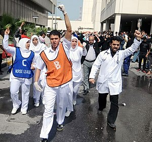 Bahrain health worker trials - Health workers protest near Salmaniya Medical Complex following reports that paramedic crews and doctors were attacked in the 17 February raid at Pearl Roundabout.