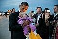 Barack Obama kisses a baby at Denver International Airport, 2012.jpg