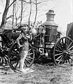 Bea Kyle Standing Fire Engine and Pickle 1924.jpg