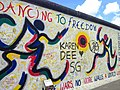 Berlin, East Side Gallery 2014-07 (Jolly Kunjappu - Dancing For Freedom).jpg