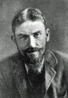 Man in early middle age, with full beard