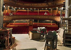 Citizens Theatre - A view of the Citizens main auditorium through a Jason Southgate designed set for The Bevellers