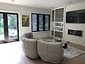 Black California shutters fitted to living room window in Toronto.jpg