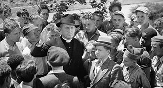 Boys Town (film) - Spencer Tracy (center) as Father Flanagan in Boys Town
