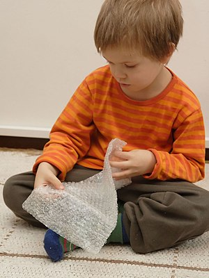 Bubble wrap - A child playing with bubble wrap