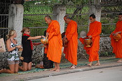 Buddhist monks collecting alms, Laos