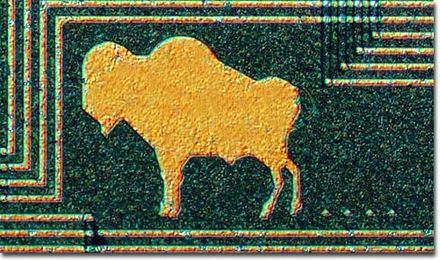 Image of a buffalo, trailing buffalo chips, etched on a digital filter chip from the HP3582a audio spectrum analyzer. Buffalo chip.jpg