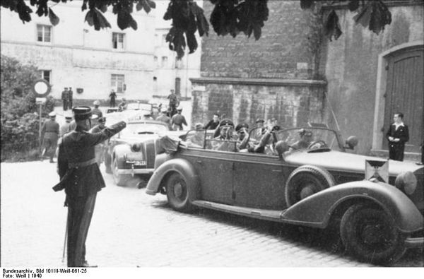 Heinrich Himmler, saluted by a Luxembourg policeman, during his visit to Luxembourg in September 1940, several months after the invasion. Bundesarchiv Bild 101III-Weill-061-25, Heinrich Himmler in Luxembourg.jpg