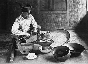 Dukun - A dukun preparing traditional medicine (Dutch colonial period, 1910-1940)