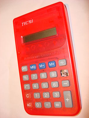 A TVC 703 Calculator with a button missing