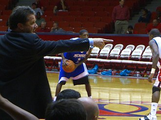 Memphis Tigers men's basketball - Calipari directing his players during an away game against Conference USA rival Houston in January 2007.