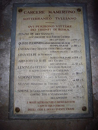 Mamertine Prison - Gravestone in Mamertine Prison, with the names of illustrious prisoners who were locked up, awaiting execution.