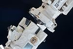 Canadarm2 grappling with a PDGF (ISS050-E-014639).jpg