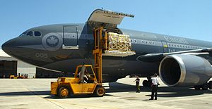 International response to Hurricane Katrina - United States Navy personnel unload Canadian relief supplies from a Royal Canadian Air Force transport aircraft in Pensacola, Florida.