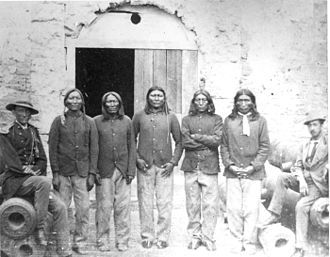 Red River War - Native American prisoners of the Red River War, Fort Marion, Florida 1875: The inscription on the back of the original stereograph says: L to R:Lone Wolf, Double Vision, White Horse, Woman's Heart, Mamante (Owl Prophet) - Kiowas. Officer left is Capt. Richard H. Pratt