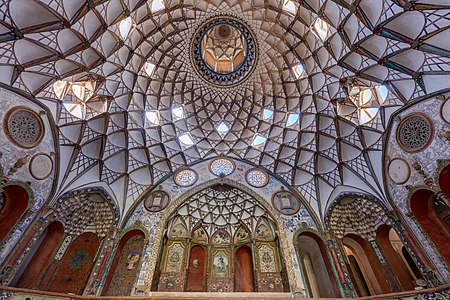 View of the rich ceiling of the interior courtyard of the Borujerdi House, a historic house located in Kashan, Iran.