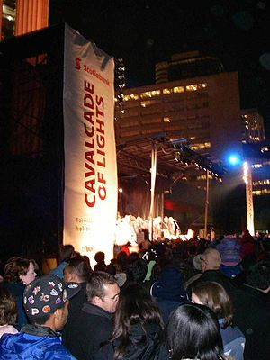 Cavalcade of Lights Festival - Cavalcade of lights banner on speaker stack, with stage in background