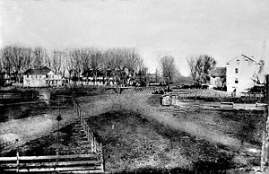 History of Chico, California - One of the earliest photographs of Chico. Bidwell's store, adobe, and mill are visible looking northwest from near modern-day First and Main streets.