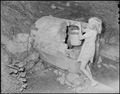 Child of a miner getting water from spring. The chief complaint in the camp concerning this water supply was that it... - NARA - 541162.tif