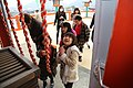 Children praying at a Japanese shrine in Kumamoto, Japan; January 2014.jpg