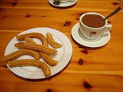 Churros served with thick hot chocolate