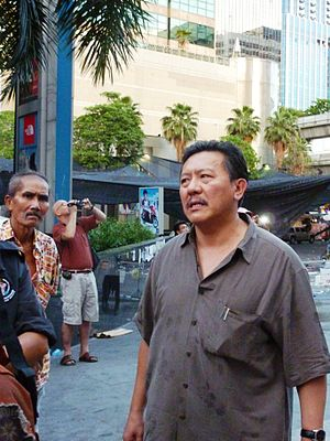 Chuwit Kamolvisit - Chuwit (right) inspected the ruins of CentralWorld on 20 May 2010 after the massive fire caused by the Red Shirts anti-government protesters.