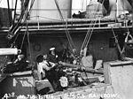 Civilian inspects gun aboard HMCS Rainbow Vancouver 1914.jpg