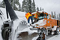 Clearing snow from plow (2947392533).jpg