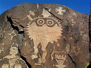 Tewa - A Southern Tewa (Tano) anthropomorphic figure with rattle, petroglyph in the Galisteo Basin, a major Tano homeland prior to the Pueblo Revolt of 1680