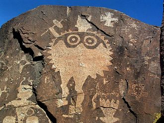 "Polly Schaafsma - Warrior with shield, Comanche Gap near Galisteo, New Mexico. This Southern Tewa petroglyph and one of a ""star person"" are featured on the cover of  Schaafsma's  Warrior, Shield, and Star."
