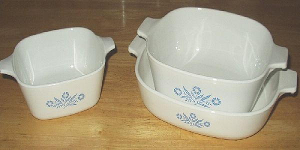 CorningWare casserole dish and other cookware pieces, with the 'Cornflower' pattern decoration Corningware casserole dishes.jpg