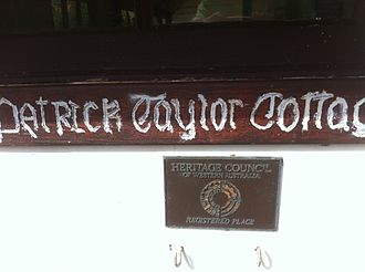 Patrick Taylor Cottage - Patrick Taylor Cottage name plate and heritage stamp