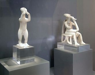 Prehistoric music - Cycladic statues of a double flute player (foreground) and a harpist (background)