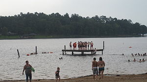 Bossier Parish, Louisiana - Swimmers at Cypress Lake on a cloudy summer day
