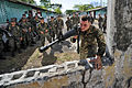 Defense.gov News Photo 110315-N-EC642-756 - U.S. Marine Sgt. Michael G. Roth demonstrates proper building entry techniques to soldiers assigned to 11th Honduran Army Battalion during a.jpg