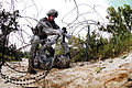 Defense.gov News Photo 110721-A-3108M-007 - A combat engineer working as part of a team cuts through a wire obstacle during a training exercise at Fort Bragg N.C. on July 21 2011. The.jpg