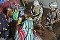 Defense.gov News Photo 111206-M-GF563-348 - U.S. Navy Petty Officer 2nd Class Kimberly Ryan right visits with Afghan women at their home in Tughay village in the Sangin district of.jpg