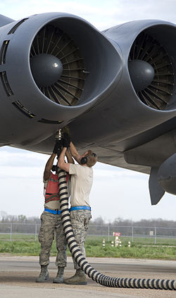 Defense.gov News Photo 120306-F-KN424-910 - Airman 1st Class Kwann Peters left and Senior Airman Bryan Turner both with the 20th Aircraft Maintenance Unit disconnect an aircraft hose from a.jpg