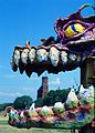 Description- The head of a Louisiana Mardi Gras float appears to devour the Smithsonian Castle during the 1985 Festival of American Folklife on the National Mall. (2536674948).jpg