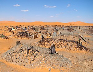 Burial - A Muslim cemetery in Sahara, all graves point across the desert placed at right angles to Mecca