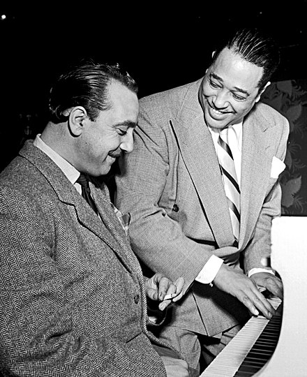 Reinhardt and Duke Ellington at the Aquarium in New York, c. November 1946 Django Reinhardt and Duke Ellington (Gottlieb).jpg